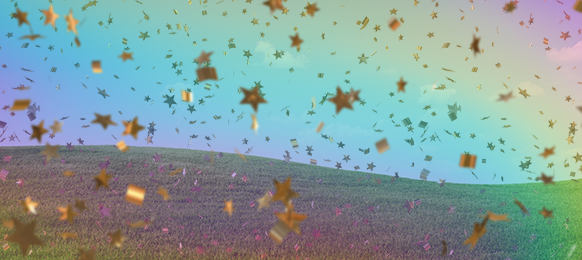 Gold confetti rains down on a field from a rainbow sky
