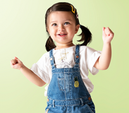 Three-year-old child dancing and smiling