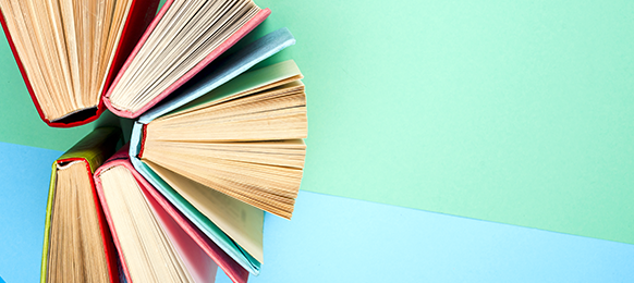 Books fanned out against a colorful background