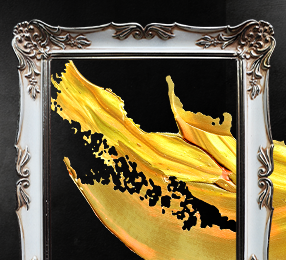A splash of yellow paint inside an ornate picture frame